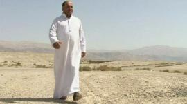 Farmer walks on desert land