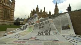 Newspapers with Westminster in background