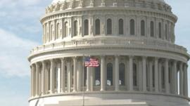 A flag flies on the Capitol