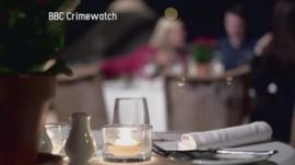 A still from a BBC Crimewatch reconstruction shows diners in a restaurant