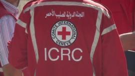 A man wearing an International Red Cross uniform