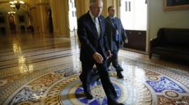 US Senate Majority Leader Harry Reid walks to his office as he arrives at the US Capitol in Washington on October 16, 2013