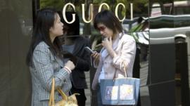Women in upmarket shopping area of Shanghai