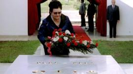 A file photo of Jovanka Broz, laying a wreath on her husband's tomb