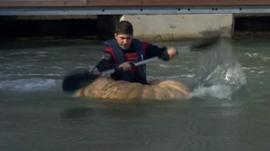 Dmitri Galitzine paddling in his pumpkin