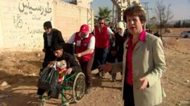 The BBC's Lyse Doucet watches as the last few citizens of the besieged Damascus suburb of Muadhamiya are taken to safety