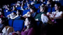 Mothers and their babies at a film screening