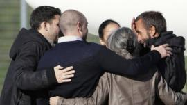 Former hostage Daniel Larribe (R) is welcomed by his family