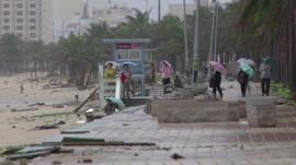 People walking along the beach in northern Vietnam