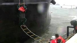 Crew being rescued a storm-stricken Chinese ship