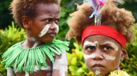 Two children celebrate the Queen's Baton Relay arrival in Papua New Guinea