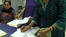 Women filling in bank forms