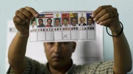 Election official holding ballot paper