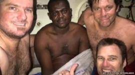 Three divers pictured with Okene