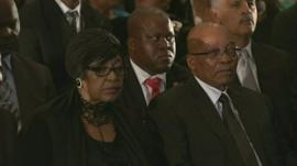 Winnie Mandela and President Jacob Zuma attend a memorial service for Nelson Mandela