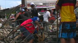 Young men helping with the clean-up in Tacloban's debris-filled streets