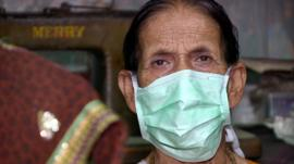 TB sufferer with paper mask