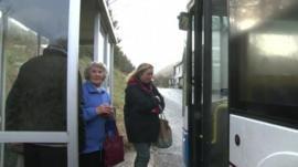 people boarding rural bus