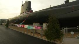 HMS Alliance in Gosport with the giant scarf