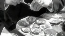 A man eating a plate of Porlock oysters