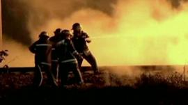 Fire-fighters in the Mexican city of Acolman try to extinguish the fire caused by the explosion of a pipeline