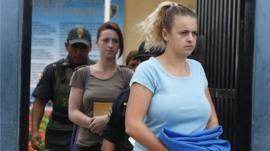 Michaella McCollum and Melissa Reid arrive for a court hearing in Lima, Peru