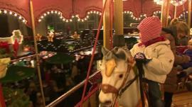 Child on carousel fair ground ride