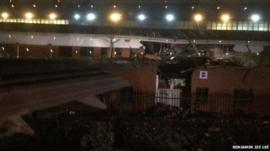 Plane wing wedged in office building