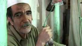 Gol Ahmad operates his 100 year old silk weaving machine