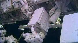 Nasa's Rick Mastracchio and Mike Hopkins moving the replacement pump into place