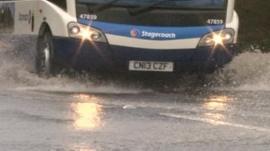 Bus driving through water