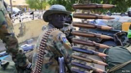 South Sudan army soldier with a machine gun