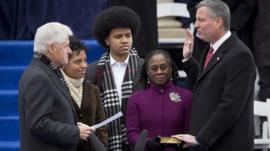 Newly elected Mayor of New York, Bill de Blasio is sworn in by former President Bill Clinton