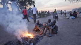 Boys around a fire in the Awerial refugee camp