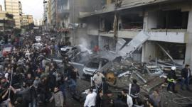 Lebanese citizens gather at the site of a car bomb explosion in Beirut