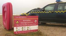 Warning signs on Cornish beach