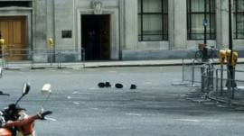 Police helmets and hats mark the spot of the fatal shooting of WPC Yvonne Fletcher outside the Libyan People's Bureau