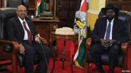 South Sudan President Salva Kiir (R) and his Sudanese counterpart Omar al-Bashir