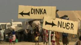 Two signs reading Dinka and Nuer