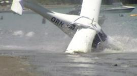 A plane crashing into the sea at Martins Bay, New Zealand