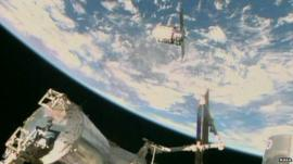 Nasa TV image shows the Orbital Sciences Corporation's unmanned Cygnus cargo ship being captured by the Canadarm after arriving at the International Space Station