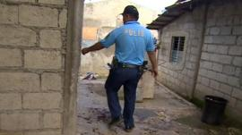 Police at the house in Ibabao, Philippines