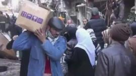 Man carries supplies
