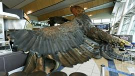 Eagle sculpture on airport floor
