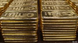 Piles of solid gold bars