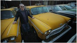 Gino Lucci by his fleet of cars