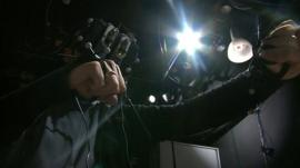 UCL's William Steptoe manipulates websites using a head-mounted display and panels on his hands