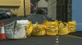 Sand bags line the street