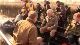 Prince Charles travels to Muchelney in Somerset by boat