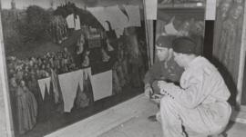 Lt Daniel J Kern and Karl Sieber examine the Ghent Altarpiece in the Altaussee mine, 1945